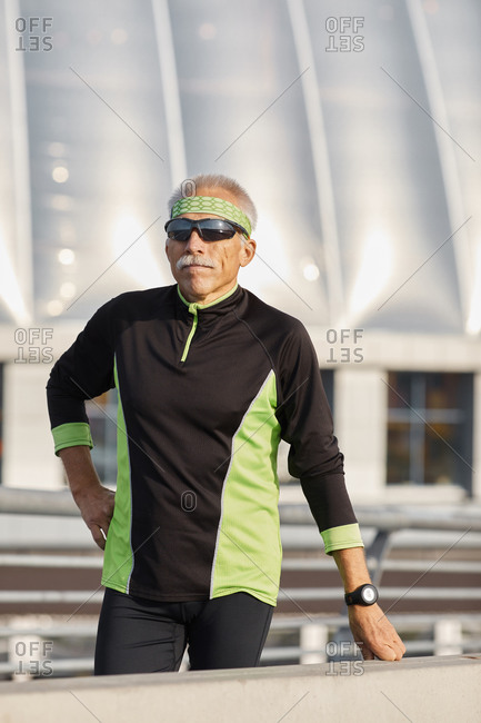 Aged man in tracksuit during workout
