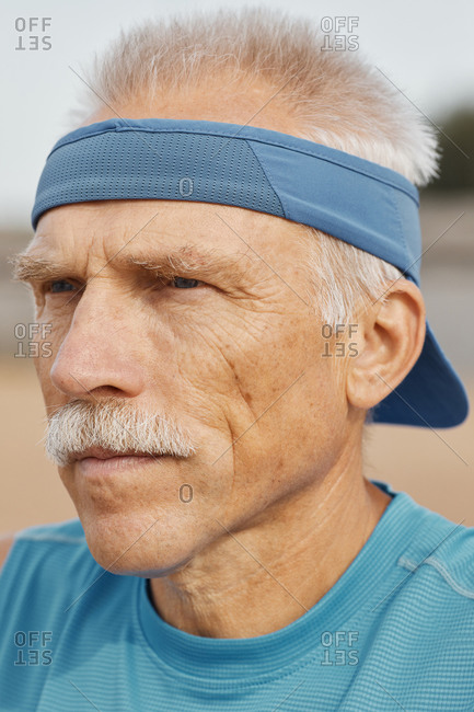 Handsome senior man in sun visor cap portrait