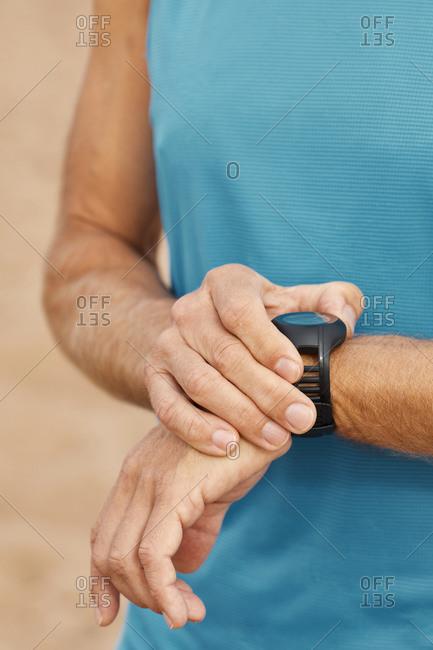 Unrecognizable man with fitness bracelet