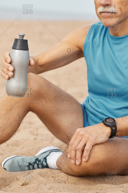 Senior man with bottle of water