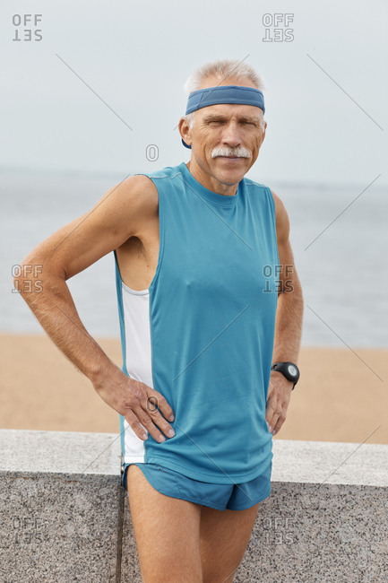 Sporty senior man with hands on hips