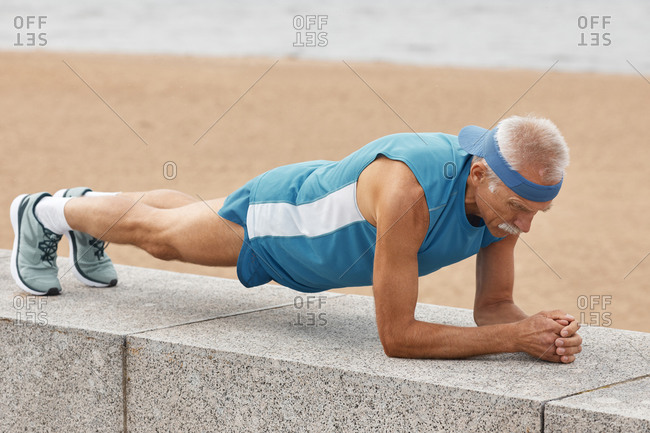 Man practicing dolphin plank pose