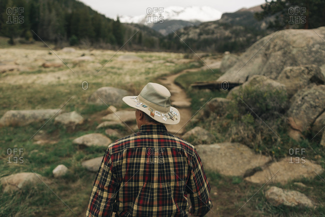 A retired man walks along a trail in rocky mountain national park, co.