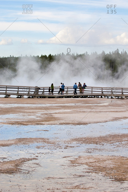 United States, Wyoming, Yellowstone National Park - June 5, 2016: People on a boardwalk at upper geyser basin, Yellowstone National Park