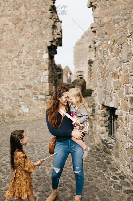 Mother and daughter exploring the remains of the Dunluce Castle in Northern Ireland