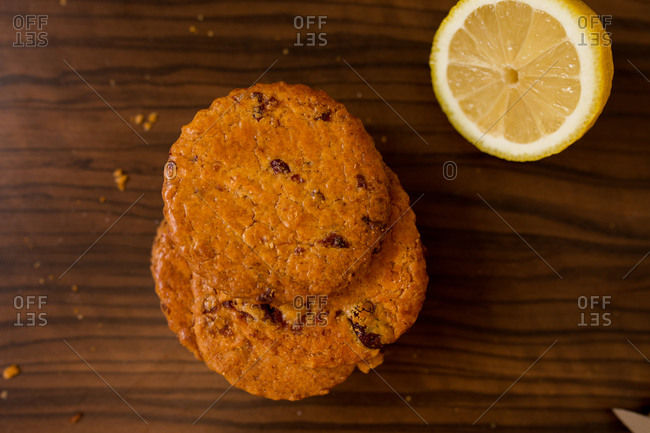 Top view of dried fruit cookies and a lemon