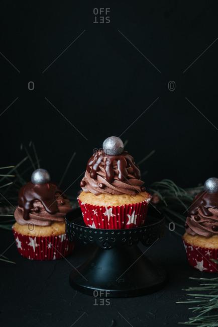 Vegan cupcakes with chocolate cream on black background