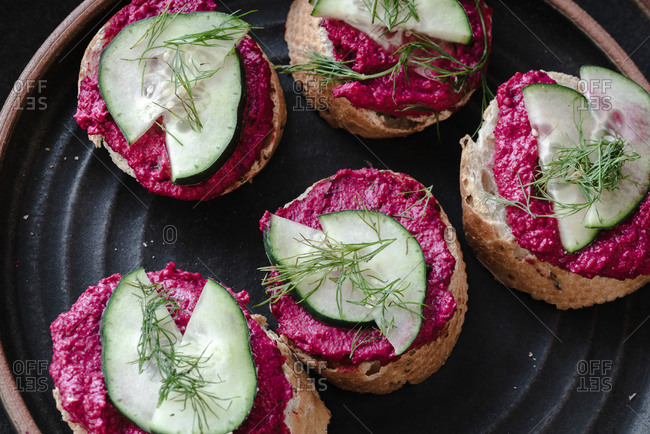 Baguette bread with beet root hummus and cucumber