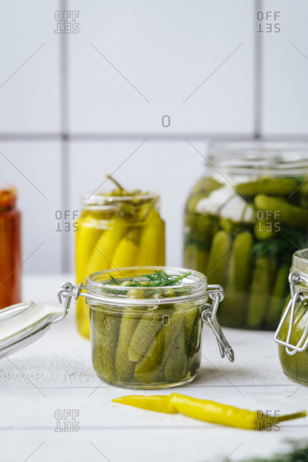 Jars of homemade sour pickles and dill