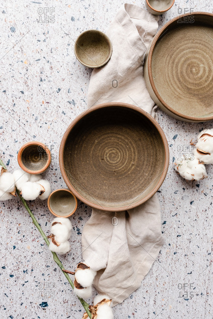 Handmade pottery on neutral background with cotton
