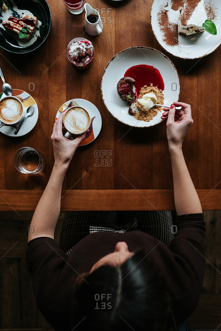 Person having coffee and desert in restaurant