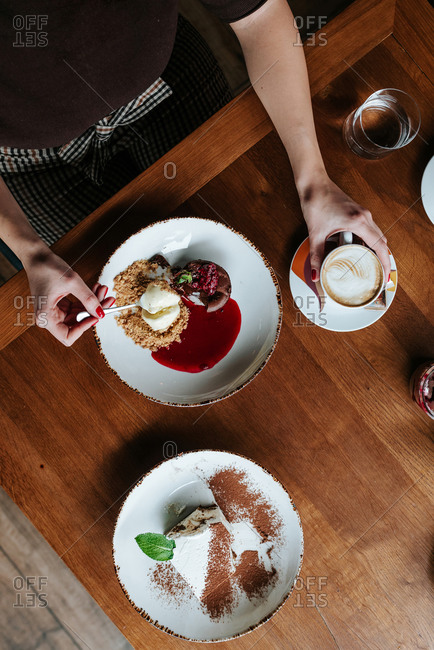 Overhead view of person having coffee and desert in restaurant
