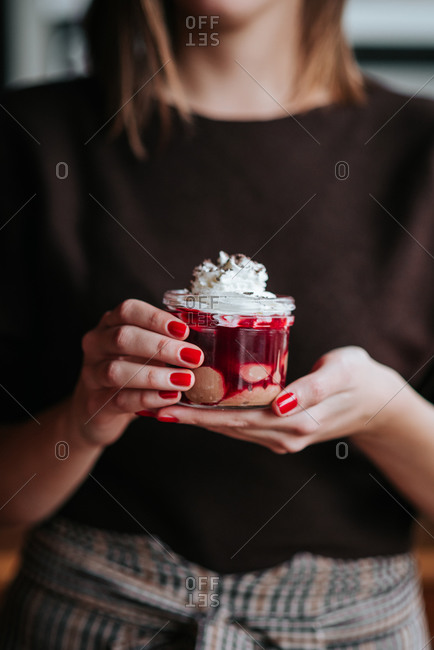 Woman holding pudding desert in her hands