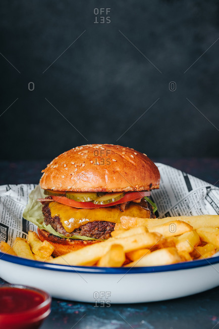 Beef cheeseburger with French fries