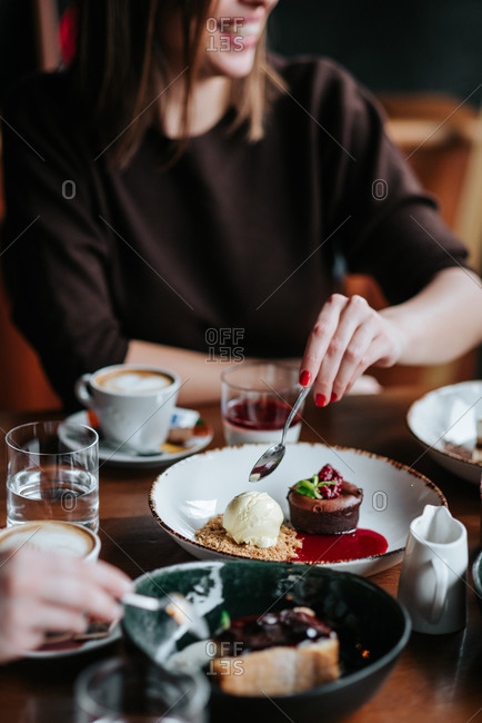 Person taking a bite of cake in a restaurant