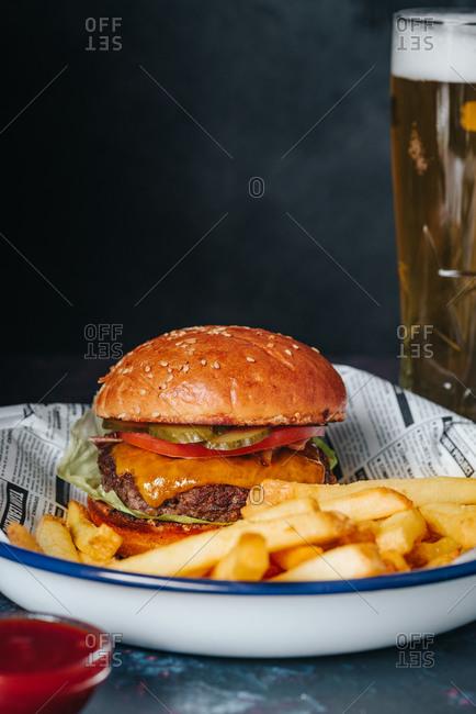 Beef cheeseburger with beer