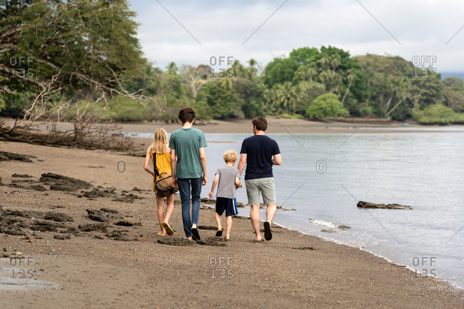 Kids and dad walking on beach, Golfo Dulce in Costa Rica