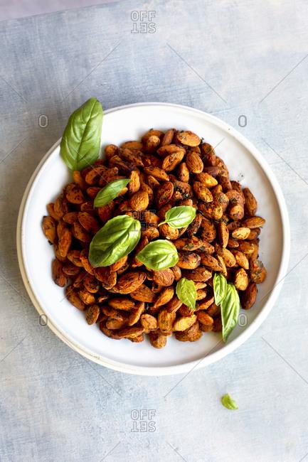 Tomato basil almonds on light background