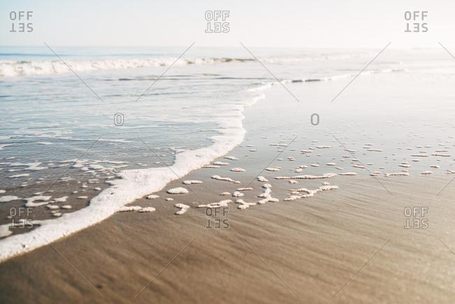 Waves rolling onto the coast of Tybee Island, Georgia