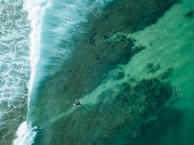 Indonesia- Sumbawa- Aerial view of surfer on sea