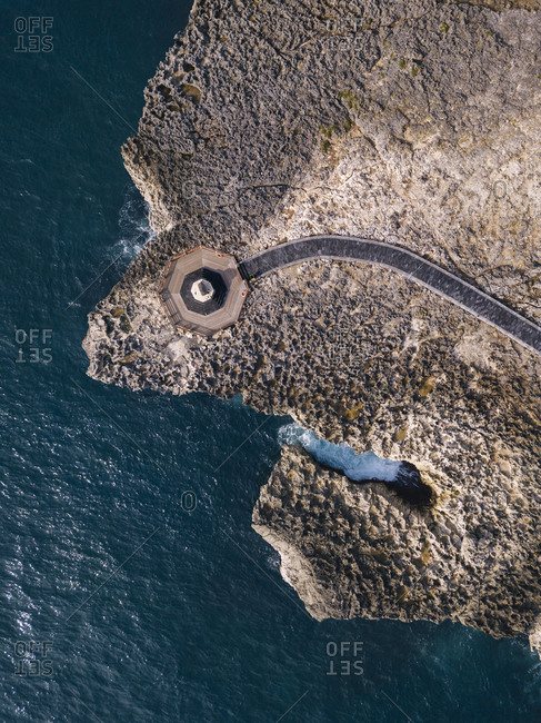 Indonesia- Bali- Nusa Dua- Aerial view of path at ocean coastline