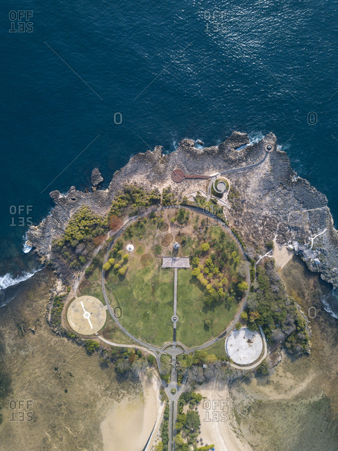 Indonesia- Bali- Nusa Dua- Aerial view of path and buildings at ocean coastline