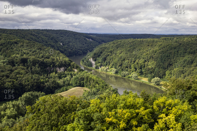 Germany- Bavaria- Kelheim- Scenic view of Danube surrounded by green forested hills