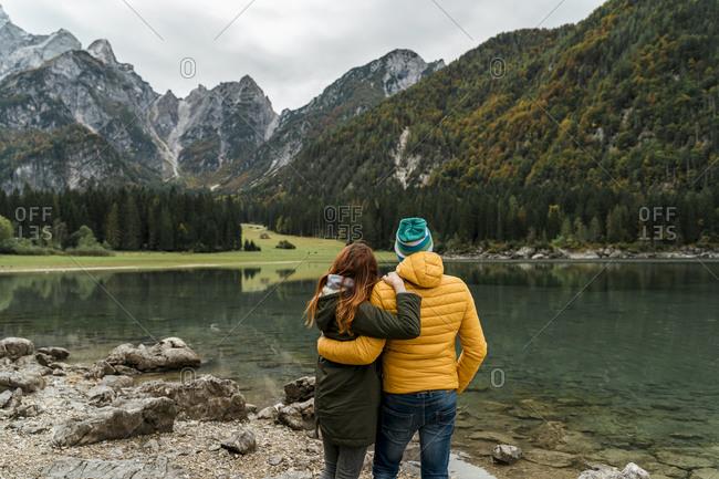Rear view of couple at Laghi di Fusine- Friuli Venezia Giulia- Italy