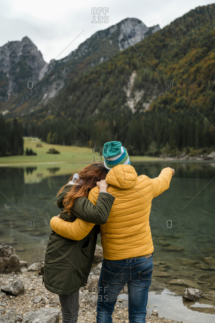 Rear view of couple at Laghi di Fusine- Friuli Venezia Giulia- Italy