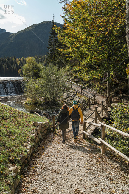 Couple hiking at Laghi di Fusine- Friuli Venezia Giulia- Italy