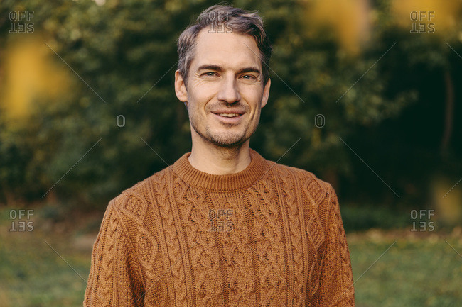 Portrait of a smiling man outdoors in autumn