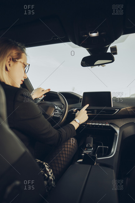 Young woman using navigation device in car