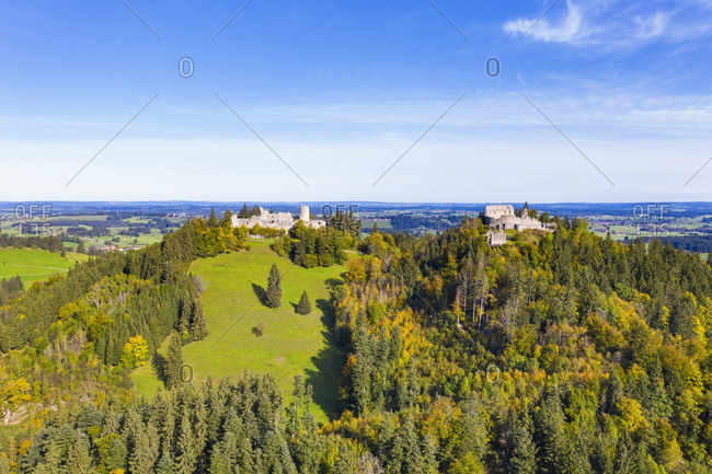 Germany- Bavaria- Eisenberg- Aerial view of ruins of Hohenfreyberg and Eisenberg castles standing on top of forested hill