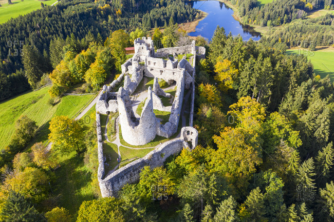 Germany- Bavaria- Eisenberg- Aerial view of ruins of Hohenfreyberg Castle standing on top of forested hill