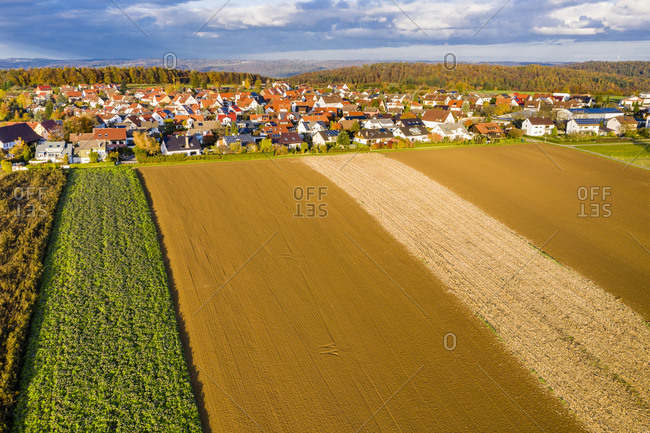 Germany- Baden Wurttemberg- Rems-Murr-Kreis- Aerial view of village and fields in Autumn