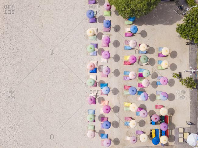 December 16, 2019: Indonesia- Bali- Nusa Dua- Aerial view of colorful umbrellas on resort beach