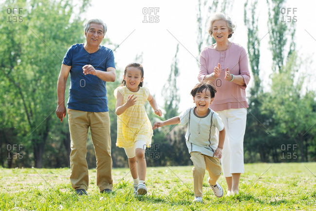 Elderly couples with children on an outing