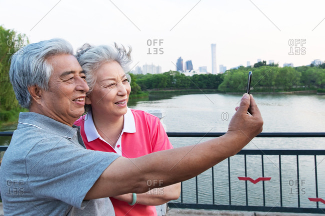 Elderly couple with mobile phones