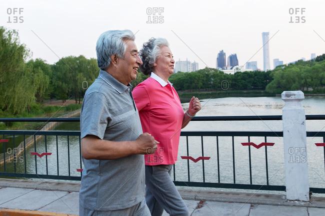 Elderly couple in the outdoor running