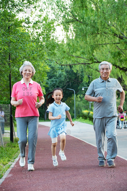 Older couples with a granddaughter in outside for a walk