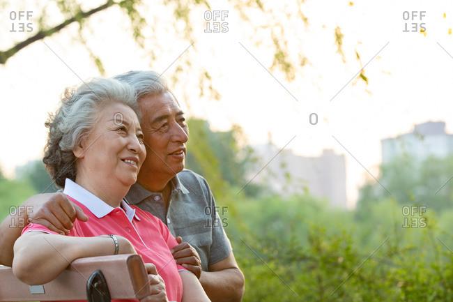 Happy elderly couple outside - Offset