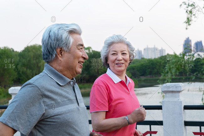 Elderly couple running outdoors - Offset