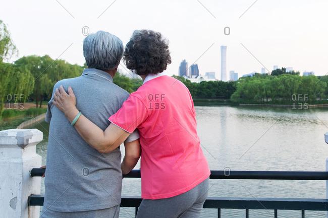 Happy elderly couple on a bridge
