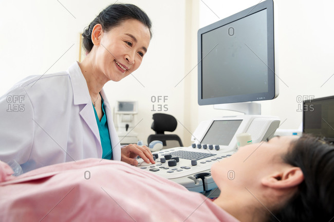 Female doctor examines her patient