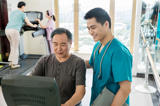 Medical workers guide their patients as they exercise