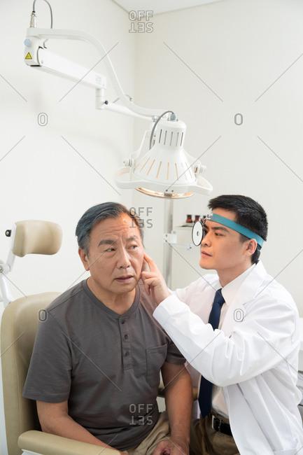 Doctor examine patient's ear