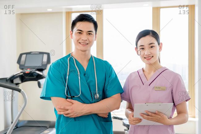 Doctors and nurses looking at camera