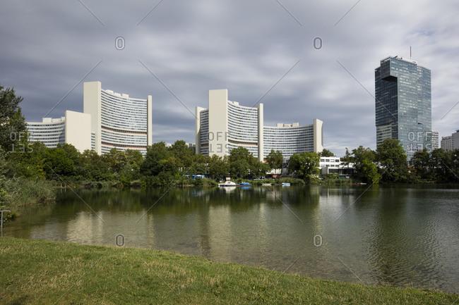 August 9, 2019: Austria- Vienna- Park lake with Vienna International Centre in background