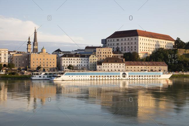 August 17, 2019: Austria- Upper Austria- Linz- Castle and cruise ship on Danube river