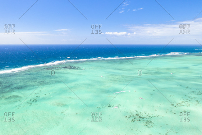 Turquoise coral reef meeting the blue Indian Ocean, aerial view by drone, Ile Aux Cerfs, Flacq district, Mauritius, Indian Ocean, Africa